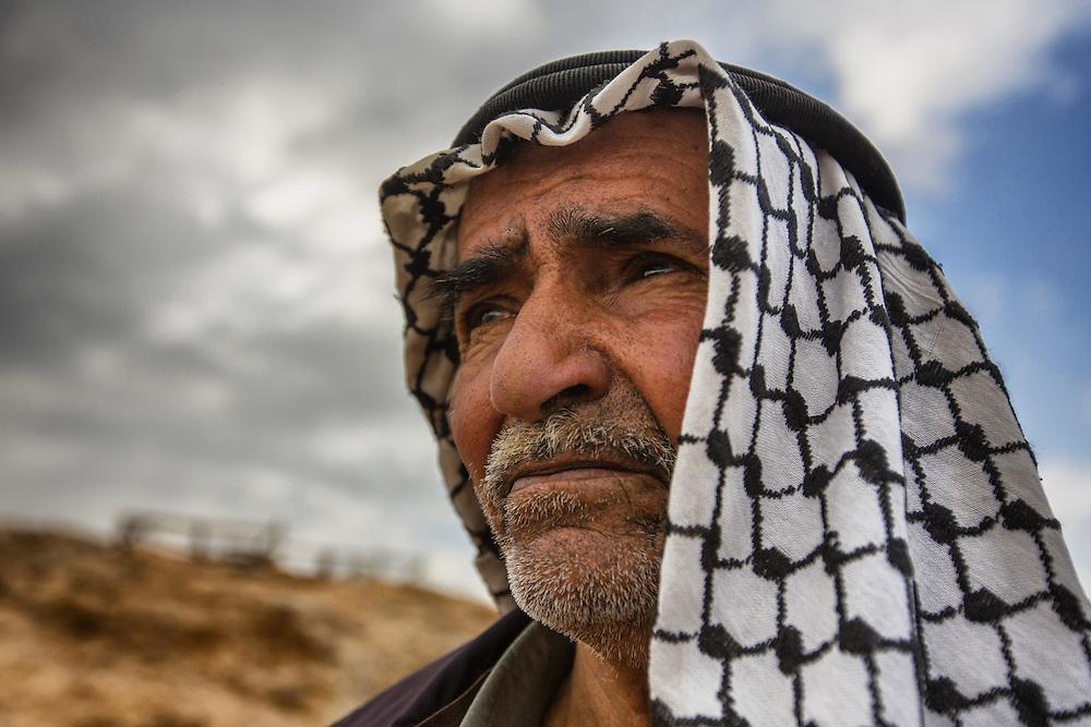 Sayya Jahalin, an elder of the village of Ein Ayoub. Dec. 28, 2013. West Bank, Palestinian Territories. (Photo by Gabriel Romero/Alexia Foundation ©2014)