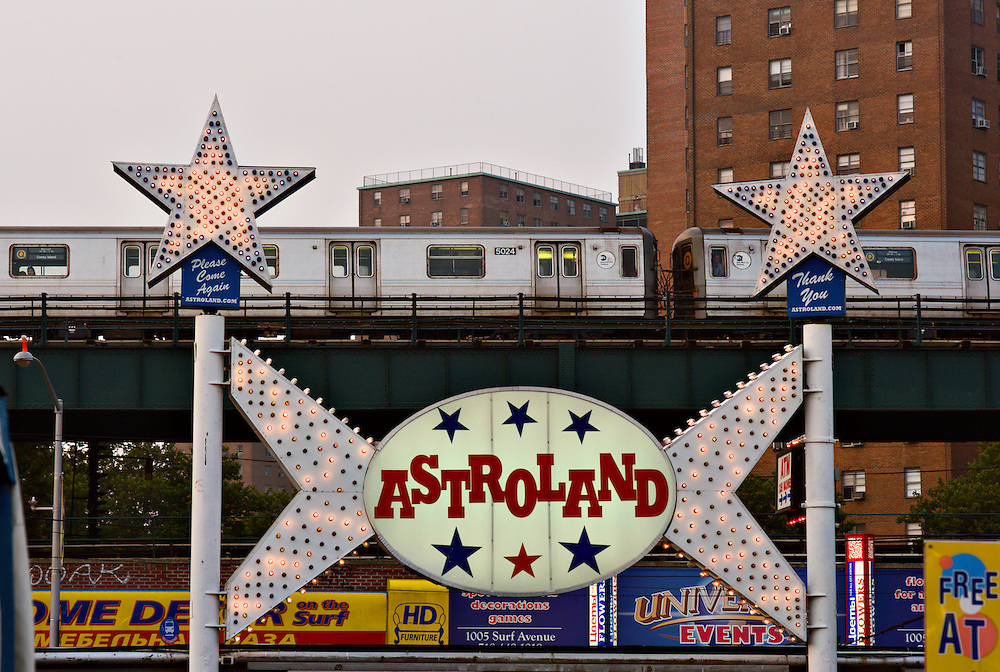 Astroland entrance sign with passing subway train, Coney Island, New York