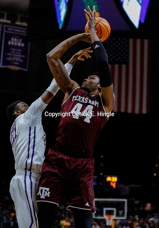 Jan 23, 2018; Baton Rouge, LA, USA; LSU Tigers forward Aaron Epps (21) blocks a shot by Texas A&M Aggies forward Robert Williams (44) during the first half at the Pete Maravich Assembly Center. Mandatory Credit: Derick E. Hingle-USA TODAY Sports
