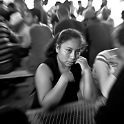 One of the deported women burst in to tears  while Father Donald Bahlinger (cq) said prayers at a food shelter called CAMDEP ( Center para la  Ayuda a  Migrante DEPortado ). This Christian group provides meals and some clothing to the deportees.
