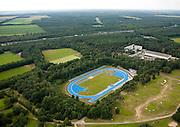 Nederland, Gelderland, Arnhem, 28-06-2006; luchtfoto (25% toeslag .Nationaal Sportcentrum Papendal, met atletiekbaan, congrescentrum,  hotel en andere faciliteiten voor sporttraining; in de achtergrond Rijksweg A50 en de bossen van Planken Wambuis, onderdeel van de Hoge Veluwe; bos, natuurmonument, atheliekbaan, training.luchtfoto (toeslag aerial photo (additional fee required .foto Siebe Swart / photo Siebe Swart