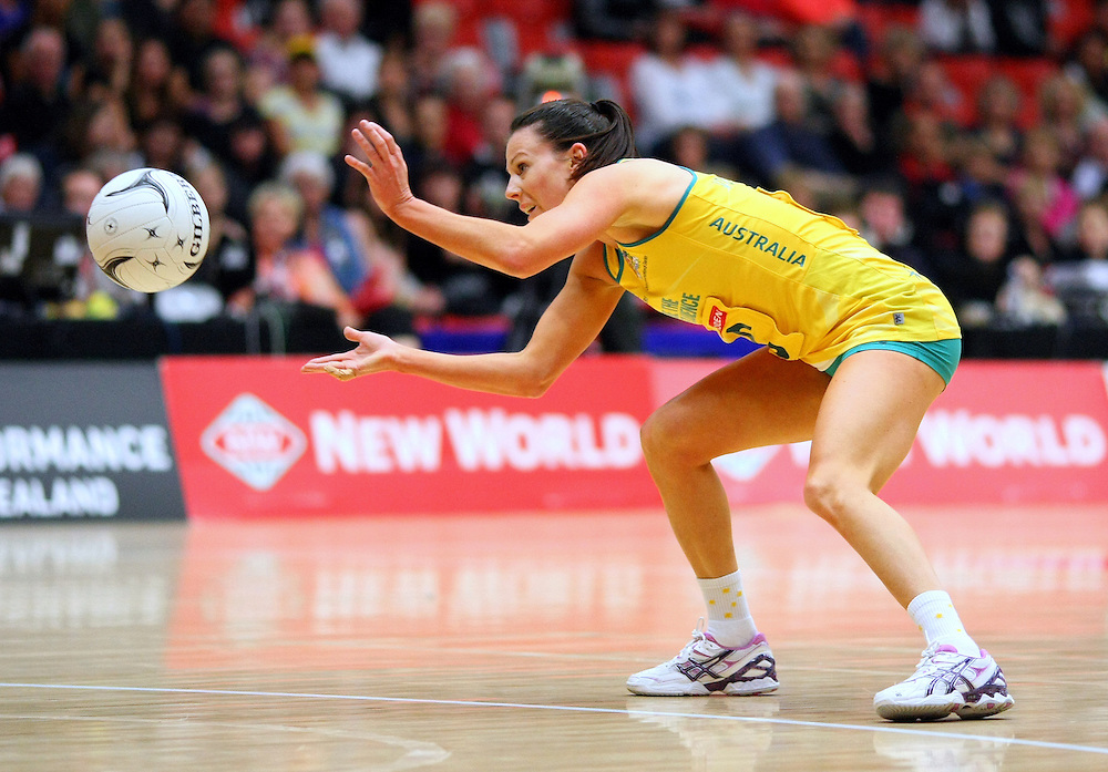 Australia's Natalie von Bertouch passes the ball against England in the New World Quad series netball match, TECT Arena, Tauranga, New Zealand, Sunday, October 28, 2012. Credit:SNPA / Dianne Manson.