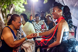 "Chantell Bernier, of the Caribbean Ritual Dancers, gives out peppermint candies to an audience members as they walk down the red carpet.  ""Timeless"" Premier at Reichhold Center for the Arts.  St. Thomas, USVI.  10 October 2015.  © Aisha-Zakiya Boyd"