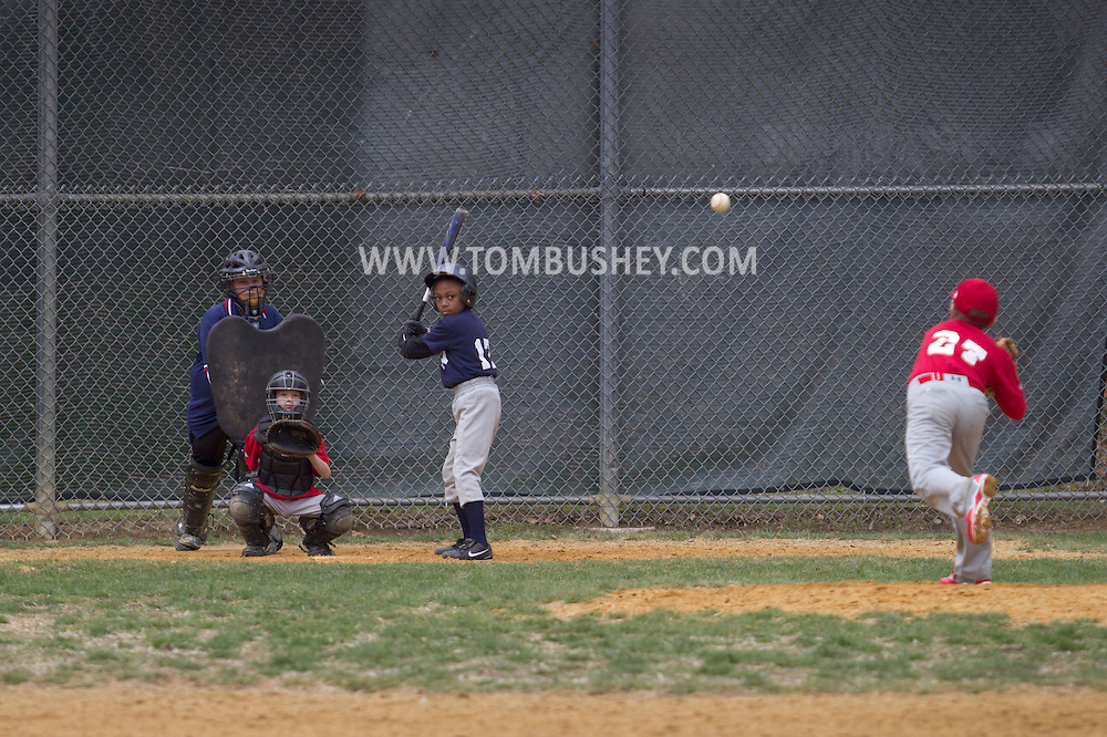 Montgomery , New York - A pitcher throws the ball toward the batter during a Little League baseball game on April 13, 2013.