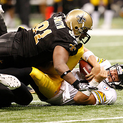Oct 31, 2010; New Orleans, LA, USA; Pittsburgh Steelers quarterback Ben Roethlisberger (7) is sacked by New Orleans Saints defensive end Will Smith (91) during the second half at the Louisiana Superdome. The Saints defeated the Steelers 20-10.  Mandatory Credit: Derick E. Hingle..