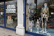 As the Coronovirus pandemic takes hold across the UK, with 53 cases now reported by health authorities, the window of a medical equipment business in south London, displays a face masks sign and surgical masks on a skeleton mannequin, on 4th March 2020, in London, England.