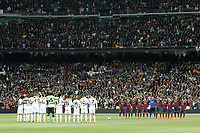 Real Madrid´s players and Barcelona´s players stand for a minutes silence as they remember former Spain Prime Minister Adolfo Suarez before La Liga match in Santiago Bernabeu stadium in Madrid, Spain. March 23, 2014. (ALTERPHOTOS/Victor Blanco)