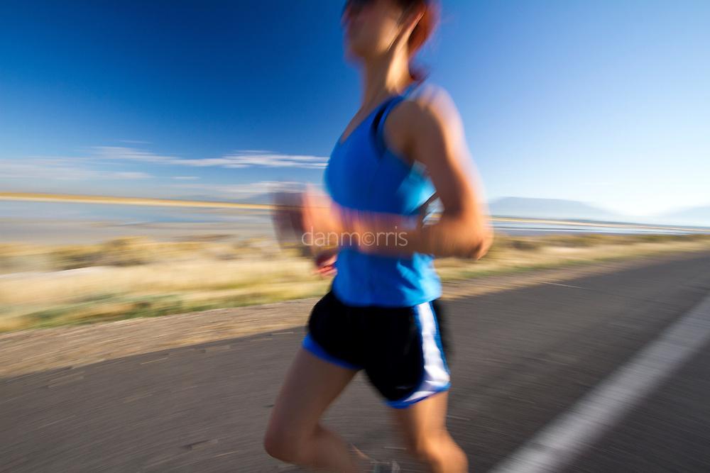 Runner on causeway at Antelope Island State Park, Utah