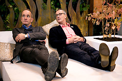 © Licensed to London News Pictures. 4/10/2013. NEC, Birmingham, UK. Grand Designs threw open it's doors today to welcome thousands of home design enthusiasts. Pictured, two men in a bed, Kevin McCloud, left and garden expert James Alexander-Sinclair find themselves relaxing together on one of the shows garden designs. Photo credit : Dave Warren/LNP