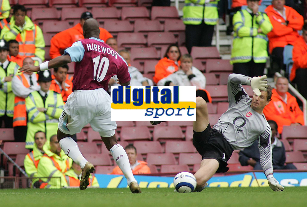 Photo: Paul Thomas.<br /> West Ham United v Arsenal. The Barclays Premiership. 24/09/2005.<br /> <br /> Arsenal keeper Lens Lehmann comes out of hie goal feet first and takes out West Ham striker Marlon Harewood, but the referee Mike Dean doesn't give the penalty.