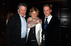 Left to right, RICHARD & JUDITH BECHER with their son HARRY BECHER at The Christmas Cracker - an evening i aid of the Starlight Children's Charity held at Frankies, Knightsbridge on 13th December 2006.<br />