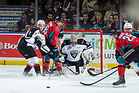 KELOWNA, CANADA - MARCH 16: Leif Mattson #28 of the Kelowna Rockets looks for the pass while Dallas Hines #2 tries to block and David Tendeck #30 of the Vancouver Giants defends the net on March 16, 2019 at Prospera Place in Kelowna, British Columbia, Canada.  (Photo by Marissa Baecker/Shoot the Breeze)