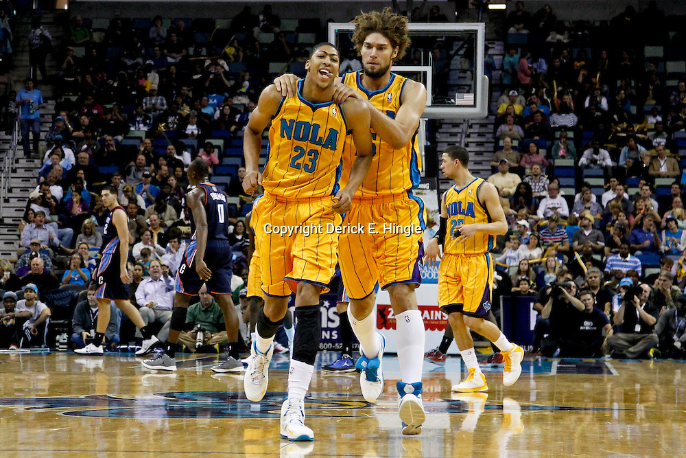 November 9, 2012; New Orleans, LA, USA; New Orleans Hornets power forward Anthony Davis (23) celebrates with center Robin Lopez (15) after scoring during the second half of a game against the Charlotte Bobcats at the New Orleans Arena. The Hornets defeated the Bobcats 107-99. Mandatory Credit: Derick E. Hingle-US PRESSWIRE