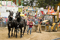 Samantha and Cristina Locke of Barnstead with Bill and Cote during the Horse Pulling events on Saturday afternoon at the Sandwich Fair.  (Karen Bobotas/for the Laconia Daily Sun)