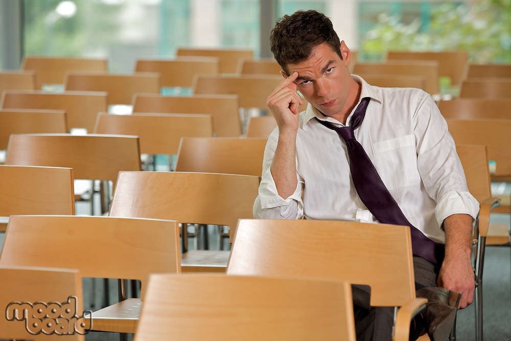 bored Businessman sitting at conference room
