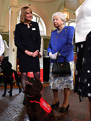 Clare Guest (left) founder of Medical Detection Dogs speaks to Queen Elizabeth II during the 10th anniversary celebration of the charity at the Royal Mews in London.