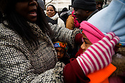 The Inauguration of President Barack Obama. Washington DC, January 20, 2009. Crowds push their way in to a security checkpoint after waiting hours in line. Two young girls in tears following a push toward the entrance.