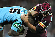 July 6th 2011: Johnathan Thurston of the Maroons tackles Akuila Uate of the Blues during game 3 of the 2011 State of Origin series at Suncorp Stadium in Brisbane, QLD, Australia on July 6, 2011. Photo by Matt Roberts / mattrimages.com.au / QRL