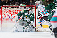KELOWNA, CANADA - DECEMBER 30: Connor Bruggen-Cate #20 of Kelowna Rockets skates behind the net of Carter Hart #70 of Everett Silvertips on December 30, 2015 at Prospera Place in Kelowna, British Columbia, Canada.  (Photo by Marissa Baecker/Shoot the Breeze)  *** Local Caption *** Connor Bruggen-Cate; Carter Hart;