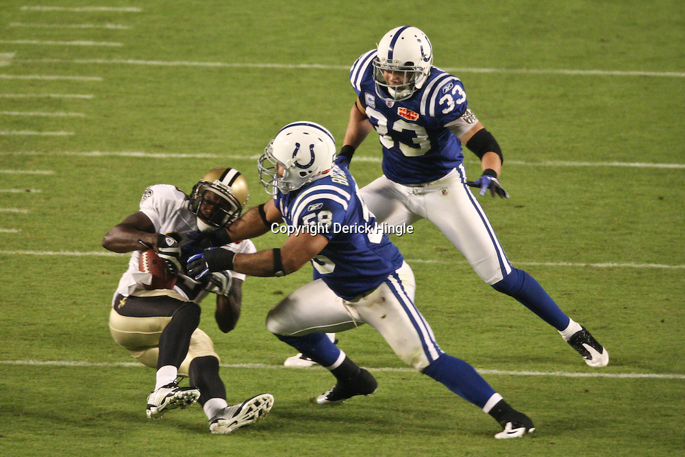 2010 February 07: New Orleans Saints wide receiver Devery Henderson (19) is tackled by Indianapolis Colts defensive tackle Eric Foster (68) and cornerback Melvin Bullitt (33) during a 31-17 win by the New Orleans Saints over the Indianapolis Colts in Super Bowl XLIV at Sun Life Stadium in Miami, Florida.