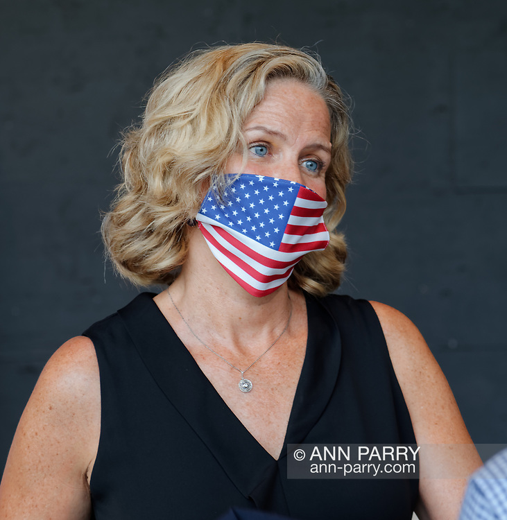 East Meadow, New York, U.S. September 10, 2020. Nassau County Executive LAURA CURRAN wears a face mask with American flag design, at the county Remembrance Ceremony at Eisenhower Park commemorating 19th anniversary of September 11 2001 terrorist attacks. The names of the 348 county residents killed were read on stage. Event was held at Harry Chapin Lakeside Theater, instead of 9/11 Memorial across the pond, because of rain prediction.