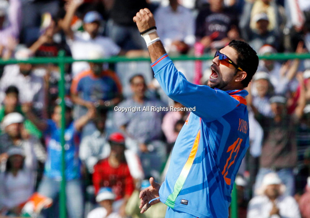 09.03.2011 Cricket World Cup from the Feroz Shah Kotla stadium in Delhi. India v Netherlands. Yuvraj Singh of India celebrates the wicket of Wesley Barresi during the match of the ICC Cricket World Cup between India and Netherlands