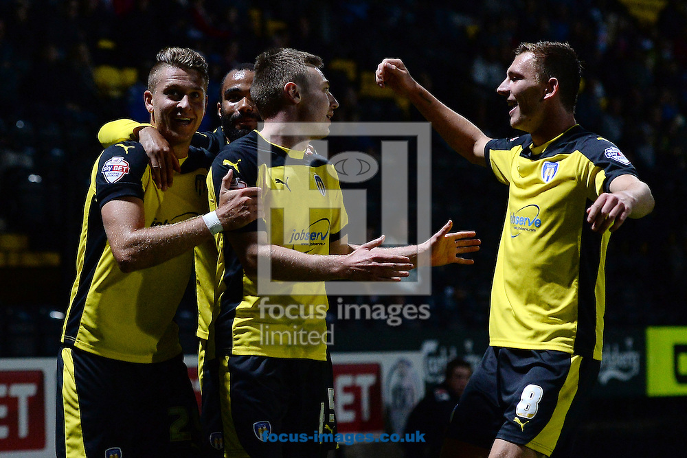 Freddie Sears of Colchester United celebrates scoring a goal to make the scoreline 1-1 during the Sky Bet League 1 match at Meadow Lane, Nottingham<br /> Picture by Richard Blaxall/Focus Images Ltd +44 7853 364624<br /> 19/08/2014