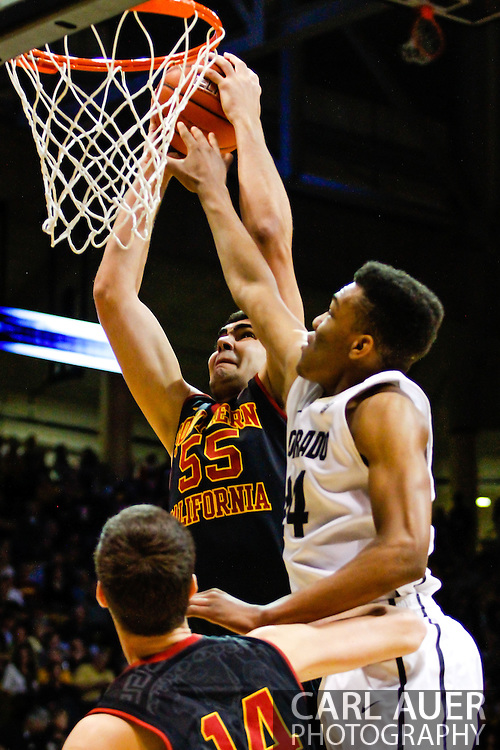 January 18th, 2014:  USC Trojans senior center Omar Oraby (55) is fouled on his shot in the first half of the NCAA Basketball game between the USC Trojans and the University of Colorado Buffaloes at the Coors Events Center in Boulder, Colorado