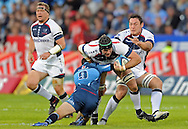 PRETORIA, South Africa, 14 May 2011. Alastair Campbell of the Melbourne Rebels is tackled by Fourie du Preez (Capt) of the Bulls during the Super15 Rugby match between the Bulls and the Melbourne Rebels at Loftus Versfeld in Pretoria, South Africa on 14 May 2011..Photographer : Anton de Villiers / SPORTZPICS