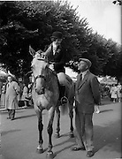 03/08/1960<br /> 08/03/1960<br /> 03 August 1960<br /> R.D.S Horse Show Dublin (Wednesday). Mr. Samuel R. Martin has a word with Mrs Roy Irvine, Lisburn at the Dublin Horse Show.
