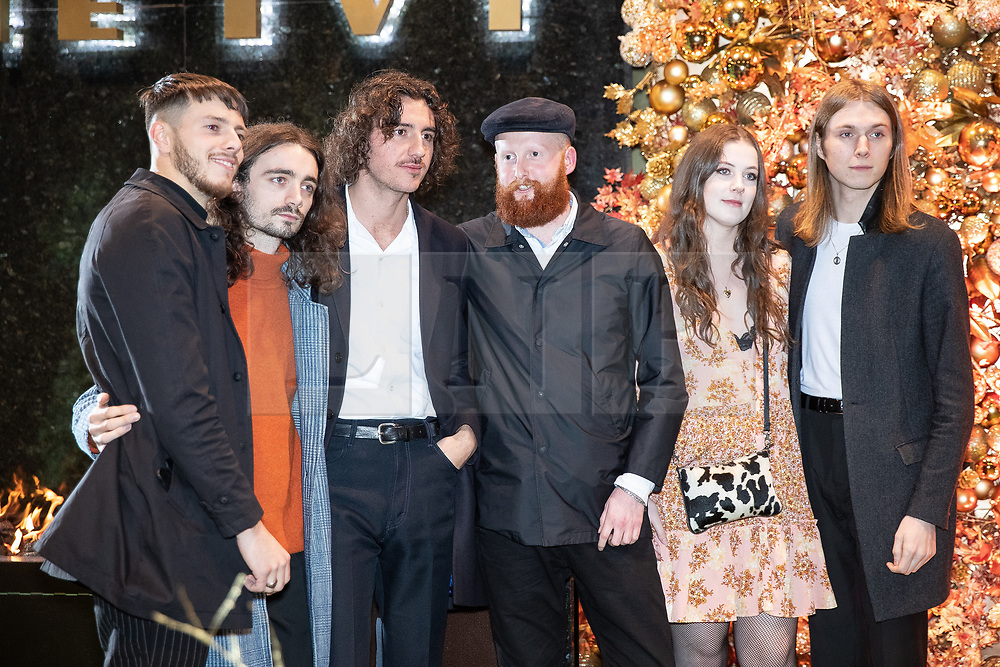 © Licensed to London News Pictures . 23/11/2018. Manchester , UK . Musicians Tom Ogden , Joe Donovan , Josh Dewhurst , Charlie Salt and Myles Kellock from Blossoms arrive at an opening event of The Ivy restaurant and bar venue in Spinningfields in Manchester City Centre . Photo credit : Joel Goodman/LNP