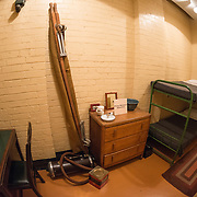 Living quarters of the Prime Minister's detectives at the Churchill War Rooms in London. The museum, one of five branches of the Imerial War Museums, preserves the World War II underground command bunker used by British Prime Minister Winston Churchill. Its cramped quarters were constructed from a converting a storage basement in the Treasury Building in Whitehall, London. Being underground, and under an unusually sturdy building, the Cabinet War Rooms were afforded some protection from the bombs falling above during the Blitz.