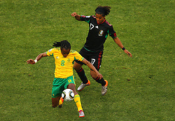 South Africa's Siphiwe Tshabalala vs Mexico's Giovani Dos Santos during the Group A first round 2010 FIFA World Cup South Africa match between South Africa and Mexico at Soccer City Stadium on June 11, 2010 in Johannesburg, South Africa.  (Photo by Vid Ponikvar / Sportida)