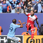 Diego Fagundez, New England Revolution, challenged by Tony Taylor, NYCFC, during the New York City FC Vs New England Revolution, MSL regular season football match at Yankee Stadium, The Bronx, New York,  USA. 26th March 2016. Photo Tim Clayton