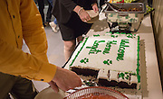 Mike Snavely and Jill Nice, who are part of the College of Business staff, cut pieces of cake to be handed out at the reception following a day of training with Sogeti on March 10, 2016. Photo by Emily Matthews