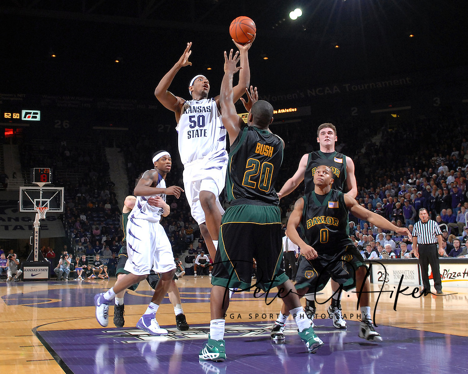 Kansas State forward Luis Colon (50) drives and shoots over Baylor's Tim Bush (20), during the second half at Bramlage Coliseum in Manhattan, Kansas, January 17, 2007.  K-State beat Baylor 69-60.