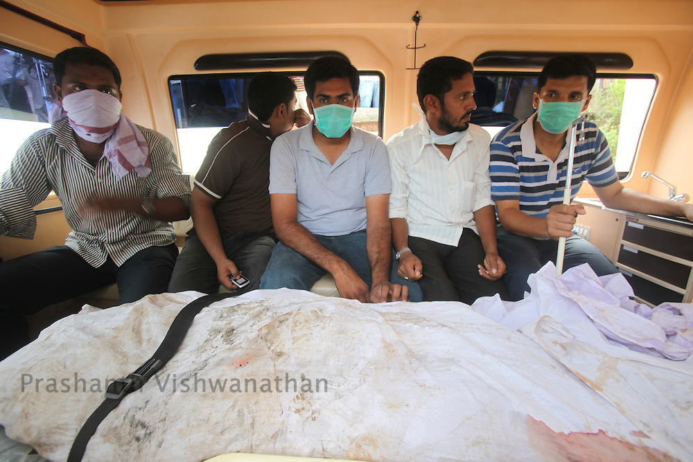 Family members bring a passenger to the mourtary, on May 23, 2010 in Mangalore. An Air India Express Dubai-Mumbai Boeing 737-800 series aircraft overshot the runway on arrival and crashed into a forest. Airline officials say 8 people have been rescued while nearly 160 others are feared dead. (Photo by Prashanth Vishwanathan/Getty Images)