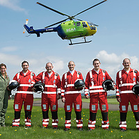SCAA..Scotland's Charity Air Ambulance paramedics pictured with Helimed 76 at the base in Perth, pictured from left, Michelle, Alex Holden, Bruce Rumgay, John Pritchard, Wayne Auton and Andy Walker.<br /> The helicopter is a Bolkow 105 supplied by Bond Aviation Services.<br /> Picture by Graeme Hart.<br /> Copyright Perthshire Picture Agency<br /> Tel: 01738 623350  Mobile: 07990 594431