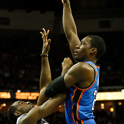 January 24,  2011; New Orleans, LA, USA; Oklahoma City Thunder forward Jeff Green (22) shoots over New Orleans Hornets small forward Quincy Pondexter (20) during the fourth quarter at the New Orleans Arena. The Hornets defeated the Thunder 91-89. Mandatory Credit: Derick E. Hingle