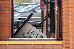 © Licensed to London News Pictures. 25/02/2020. Gerrards Cross, UK. Parts of a damaged ATM on the floor after a Barclays Bank next to Gerrards Cross train station was targeted in an overnight robbery. Photo Credit: Peter Manning/LNP