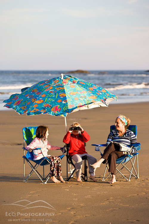 A woman and her two kids in beach chairs at Popham Beach State Park in Phippsburg, Maine.