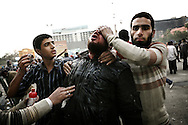 During clashes against Egyptian President supporters, a wounded anti Mubarak protestor is brought to a medical post in Tahrir Square. 02 February 2011.