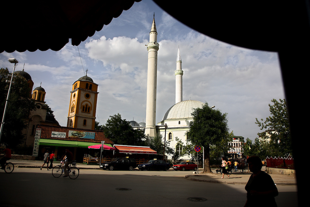A mosque and an Orthodox church standing side by side in the primarily Albanian city of Gjilan, south of Pristina...Gjilan, Kosovo, Serbia.