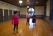 Peggy Whitworth (from right) talks with Jim Hoffman as his wife Ann Hoffman, all of Cedar Rapids, looks on at the CSPS Hall Grand Re-opening in Cedar Rapids on Friday evening, August 26, 2011. Whitworth is the vice chair of the Legion Arts Board. About 190 people attended the event which featured a concert by Susan Werner.