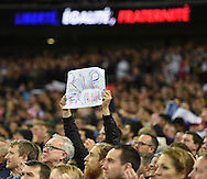 Fans with banners in memory of the victims of the recent attacks in France during the Breast Cancer Care International Friendly match at Wembley Stadium, London<br /> Picture by Daniel Hambury/Focus Images Ltd +44 7813 022858<br /> 17/11/2015