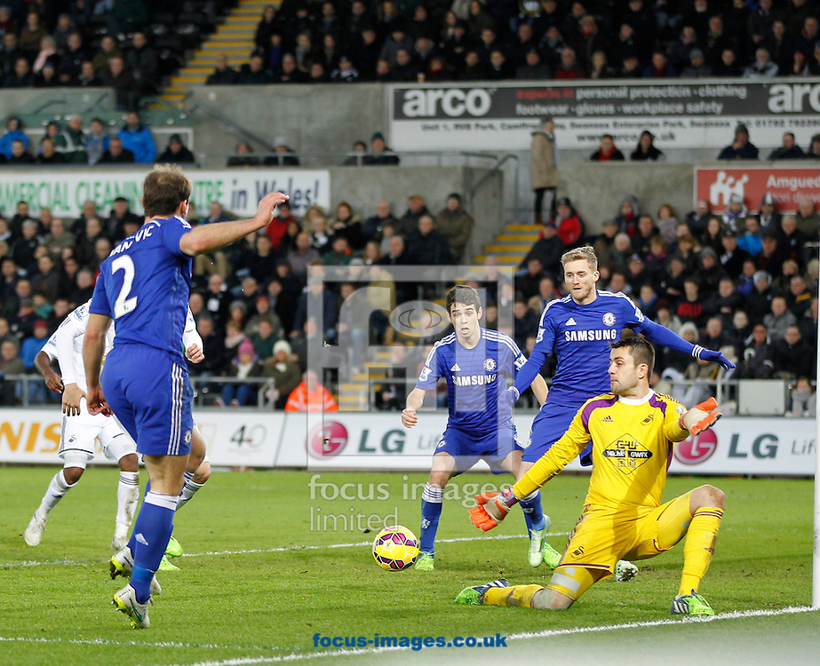 Andre Schurrle of Chelsea scores the fifth goal during the Barclays Premier League match at the Liberty Stadium, Swansea<br /> Picture by Mike Griffiths/Focus Images Ltd +44 7766 223933<br /> 17/01/2015