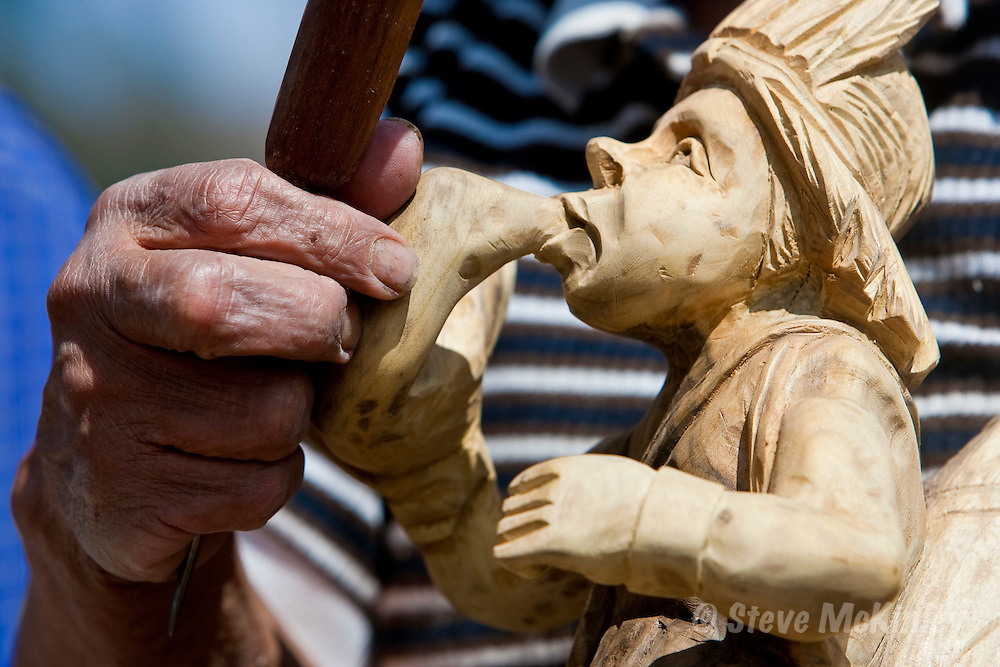 CAYAMBE, ECUADOR: August03, 2005 -- CAYAMBE DAY 2 -- Man works on carved wooden figures at the equator as Flavia Ferrero and Steve arrive in Cayambe Aug. 3...Steve McKinley Photo.