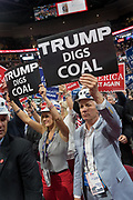 GOP delegates cheer and wave signs in support of Coal Mining during the Republican National Convention July 20, 2016 in Cleveland, Ohio.