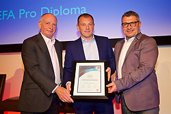 NEWPORT, WALES - Friday, May 18, 2018: Richard Williams receives his UEFA Pro Licence Diploma from Lennie Lawrence (left) and Wales technical director Osian Roberts (right) during day one of the Football Association of Wales' National Coaches Conference 2018 at the Celtic Manor Resort. (Pic by David Rawcliffe/Propaganda)