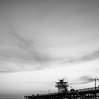 San Clemente pier at dusk black and white picture. San Clemente is a popular beach city in Orange County Southern California in the United States of America. Copyright ⓒ 2017 Paul Velgos with all rights reserved.